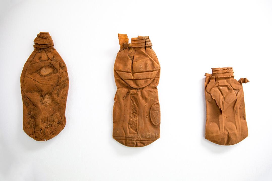 <b>Roadside archaeology II 2016</b><br /> installation view<br /> Plastic bottles, entomology pins